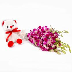 Adoreable Teddy Bear with Purple Orchids Bunch