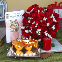 Anniversary Half Kg Butterscotch cake and Red Roses Bouquet with Candle