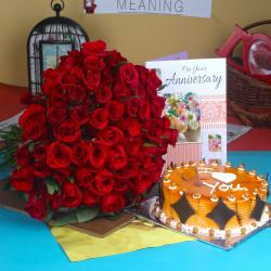 Anniversary Half Kg Butterscotch Cake with Greeting Card and Red Roses