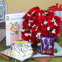 Anniversary Half kg Vanilla Cake and Fifty Red Roses with Chocolates