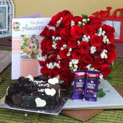 Anniversary Heart Shape Chocolate Cake and Fifty Roses Bunch with Chocolates