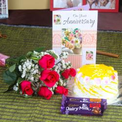 Anniversary Roses with Eggless Cake and Fruit n Nut Chocolates