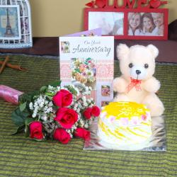 Anniversary Six Red Roses with Eggless Pineapple Cake and Teddy Bear