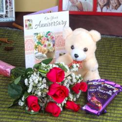 Anniversary Teddy Gift Pack with Six Roses and Silk Chocolates