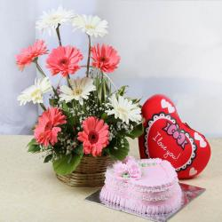 Arrangement of Gerberas with Heart Cushion and Strawberry Cake