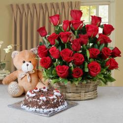 Arrangement of Red Roses and Half Kg Black Forest Cake and Teddy