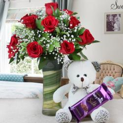 Arrangement of Ten Roses and Cute Teddy with Chocolate