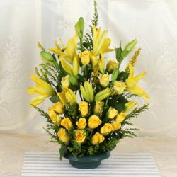 Arrangement of Yellow lilies and Roses