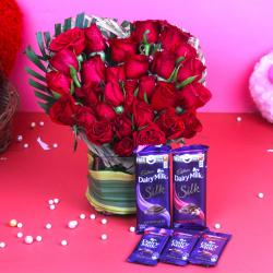Assorted Cadbury Chocolate with Red Roses Arrangement