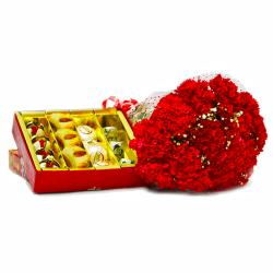 Assorted Indian Sweets with Bouquet of Fifteen Red Carnations