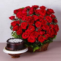 Basket Arrangement of Fifty Red Roses with Chocolate Cake