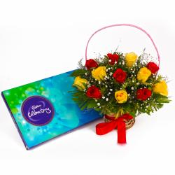 Basket of Twelve Red and Yellow Roses with Cadbury Celebration Chocolates