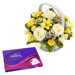 Beautiful basket of yellow and white roses with Celebration pack