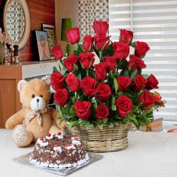 Black Forest Cake and Basket Arrangement of Red Roses with Teddy Bear