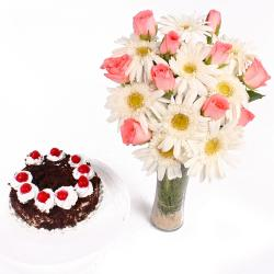 Black Forest Cake and Glass Vase of Pink Roses with White Gerberas