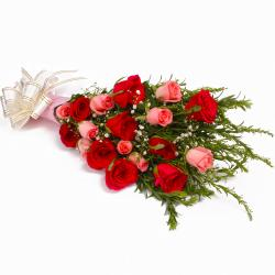 Bouquet of 18 Pink and Red Roses in Tissue Wrapping