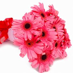 Bouquet of Ten Pink Gerberas in Tissue Wrapped