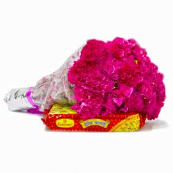 Box of Soan Papdi with 15 Pink Carnations Flowers