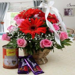 Cadbury Fruit N Nut Chocolate and Rasgulla with Mix Flower Arrangement
