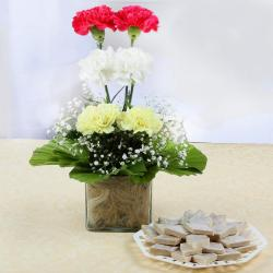 Charming Carnations in Vase with Kaju Katli Sweets