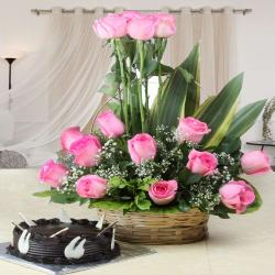 Charming Pink Roses Arranged in Basket with Chocolate Cake