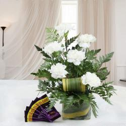 Combo of Cadbury Dairy Milk Chocolate with White Carnation Arrangement