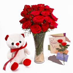 Cute Teddy with Red Roses Vase and Greeting Card Combo