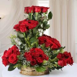 Designer Arrangement of Fifty Red Roses in Basket