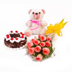 Dozen Pink Roses Bunch and Half Kg Black Forest Cake with Teddy Bear