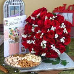Dry Fruit and Fifty Red Rose Hand Bunch with Anniversary Greeting Card
