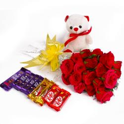 Eighteen Red Roses Bunch and Cute Teddy with Assorted Chocolate Bars