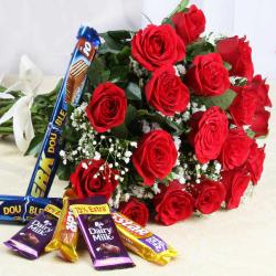 Exotic Red Roses Bouquet with Assorted Chocolate Bars