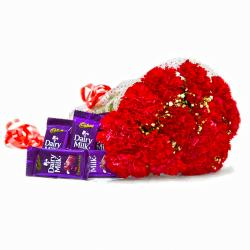 Fifteen Red Carnation with Bars of Cadbury Dairy Milk Chocolates