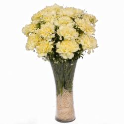 Fifteen Yellow Carnations in Glass Vase
