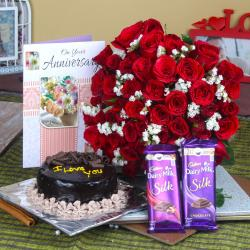 Fifty Red Roses Bouquet and Anniversary Cake with Chocolates