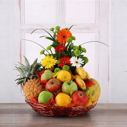 Gerberas Arrangement with Assorted Fresh Fruits