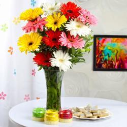 Gerberas vase with Kaju sweets and Holi colors