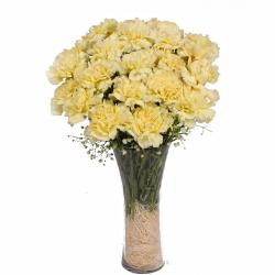 Glass Vase of 16 Yellow Carnations