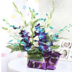 Glass Vase of Mix Orchids with Cadbury Chocolates