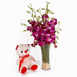 Glass Vase of Orchids and Cuddly Bear