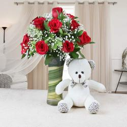 Glass Vase of Red Roses with Teddy Bear