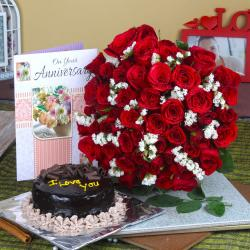 Half Kg Chocolate Cake and Fifty Red Roses with Anniversary Greeting Card