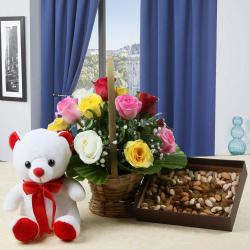 Hamper of Colorful Roses Arrangement and Teddy Bear with Dry Fruits