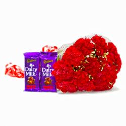 Hand Tied Red Carnations with Cadbury Dairy Milk Fruit N Nut Bars