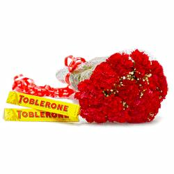 Lovely Fifteen Red Carnation with Toblerone Chocolate Bars