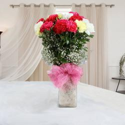 Lovely Two Dozen Mix Carnations in Glass Vase