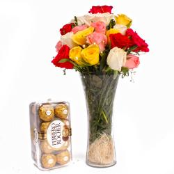 Multi colour Roses arrange in a Vase and 16 pcs Ferrero Rocher Chocolates