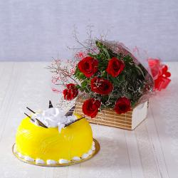 One kg Pineapple Cake with Six Red Roses Hand Tied Bouquet