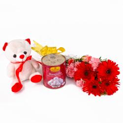 Rasgulla with Fresh Carnations and Gerberas Bouquet with Soft Toy Combo