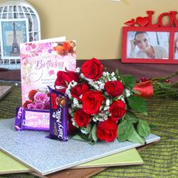 Red Roses and Birthday Card with Chocolates